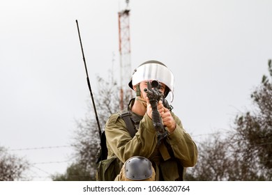 Bilin, Palestine, December 31, 2010: Israel Defence Force is getting ready to shoot tear gas during weekly demonstrations against Palestinian land confiscation and building Jewish settlement in Bilin.