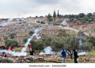 Bilin, Palestine, December 31, 2010: Palestinian protesters are facing IDF squad during weekly demonstrations against Palestinian land confiscation and building Jewish settlement in Bilin.