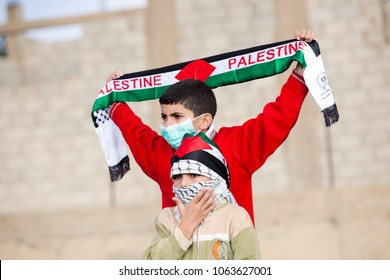 Bilin, Palestine, December 31, 2010: Palestinian children during weekly demonstrations against Palestinian land confiscation and building Jewish settlement in Bilin.