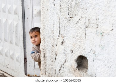 Bilin, Palestine, December 31, 2010: Palestinian boy is standing in the doors of his household in the village of Bilin, north of Ramallah.