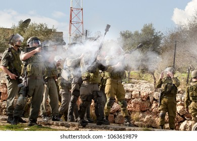 Bilin, Palestine, January 1, 2011: Israel Defence Force is shooting tear gas during demonstration against Palestinian land confiscation and building Jewish settlement in Bilin.