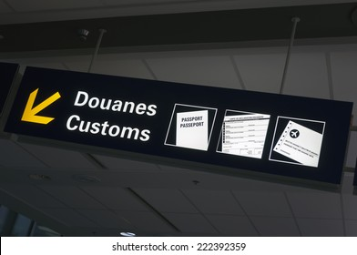 Bilingual customs and passport control sign at international airport.