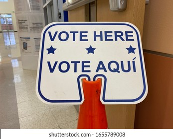 Bilingual sign VOTE HERE VOTE AQUI to direct voters to the polling place