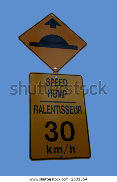 Bilingual speed hump sign sign isolated on blue