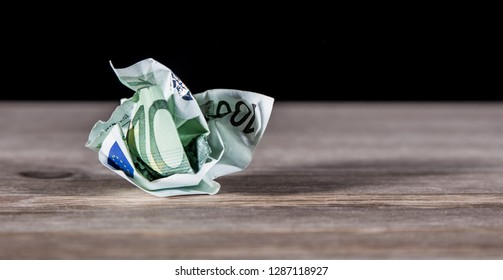 a bill lies crumpled on a table