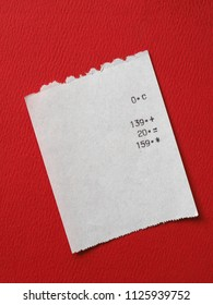 bill or receipt over bright red paper background