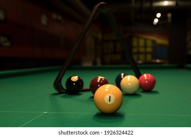 billard colored,balls with nambers on the table,a trigon.Useful for design-works