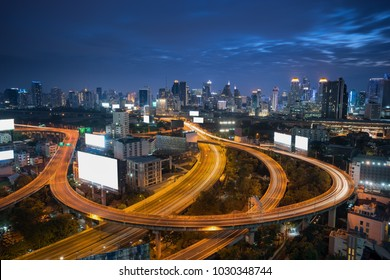 Billboard beside curve bridge and city background in center of Bangkok, Thailand