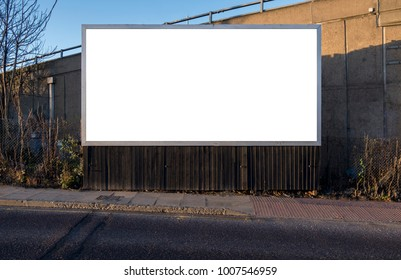Billboard blank near road pavement for outdoor advertising poster or blank billboard for advertisement