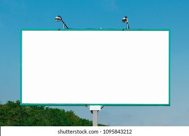 Billboard, billboard, canvas billboard, layout against the blue sky. The concept of outdoor advertising, marketing, sales. mockup
