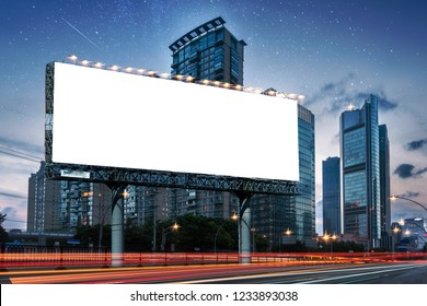 Billboard clear mock up in night streets of city useful for design