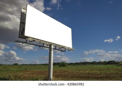 Billboard - Empty billboard in front of beautiful cloudy sky in a rural location