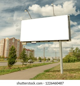 Billboard mockup in city background. suny summer weather , cloudy sky