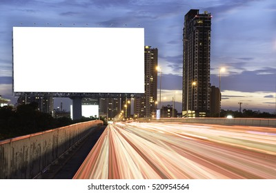 Billboard mockup outdoors, Outdoor advertising poster at night time with street light line for advertisement street city night. With clipping path on screen