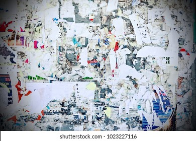Billboard With Old Torn Ads And Posters Horizontal Grunge Vintage Background. Urban Playbill Colorful Texture For Text Or Image.  Wooden Tattered Advertising Panel With Torn Paper Surface