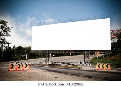 billboard on bridge with road and sky background