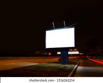 Billboard on the road at night, long exposure