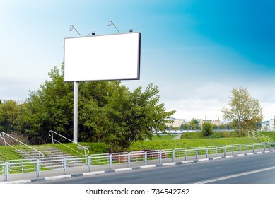 A Billboard on the side of the road