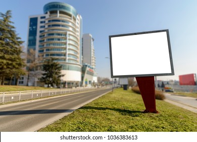 Billboard on the side of the Road against Blurry background