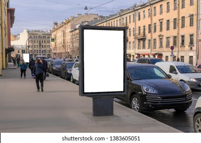 Billboard on the streets. vertical Billboard advertising on the background of the city and cars parked on the side of the road. Porsche mockup