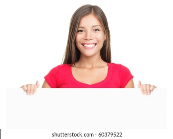 Billboard sign woman smiling. Casual business woman showing blank white placard Young Asian / Caucasian female model isolated on white background.