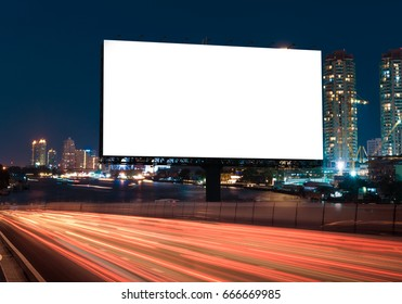 Billboard street on light trails for outdoor advertising poster or blank billboard at night time for advertisement. street light.- can for display or montage product or business.