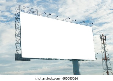 Billboard structure with blue clouds.