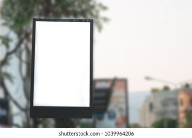 Billboard with white screen at bus stop for advertiser or notice.