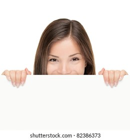 Billboard woman looking over sign isolated on white background. Mixed race Asian Caucasian female model looking.