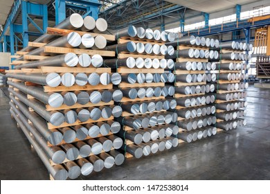 Billets of aluminium in the factory. Manufacturing process by which a liquid material is usually poured into a mold, which contains a hollow cavity of the desired shape, and then allowed to solidify.