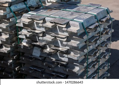 Billets or ingots of raw aluminium products.  Hoopes process involves the electrolysis of molten aluminium with a sodium, barium, and aluminium fluoride electrolyte.
