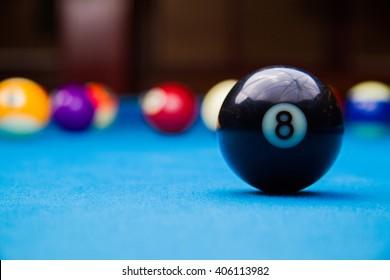 billiard 8 ball on blue billiard table