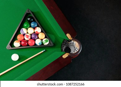 Billiard ball in the triangle on the billiard table, American billiards. Sports games, outdoor activities.