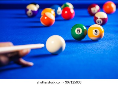 billiard balls in a blue pool table