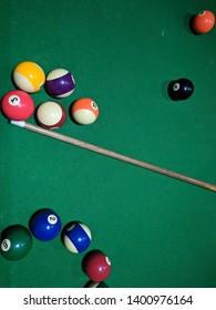 Billiard balls in a green pool table