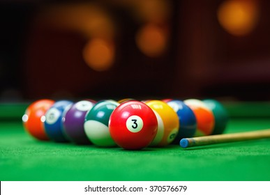 Billiard balls in a green pool table, game