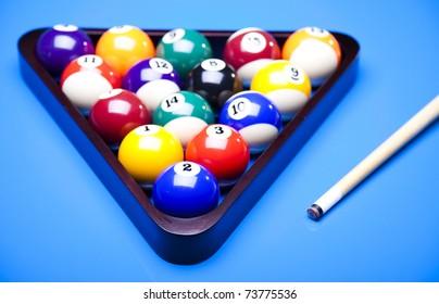 Billiard balls isolated on blue