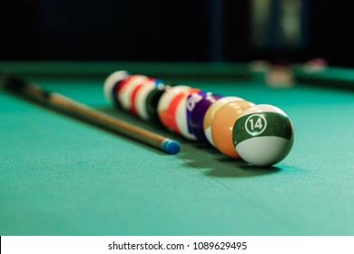 Billiard balls are lined up on a billiard table, American billiards. Sports games, outdoor activities.