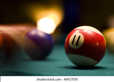 Billiard balls in motion on a pool table