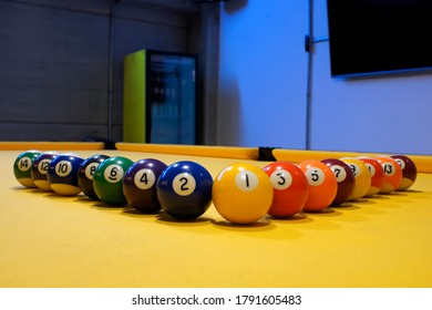 Billiard balls, odd on one side and even on the other.