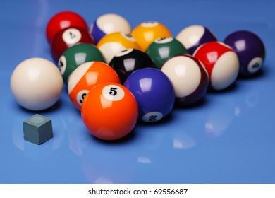 Billiard balls on blue shiny background