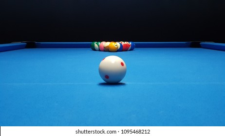 billiard balls on blue billiard table. Perfect composition of pool balls.