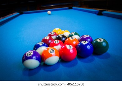 billiard balls on blue billiard table