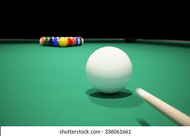 Billiard balls on the green baize of a billiard table. Breaking the rack in pool.Strong shot of cue ball.