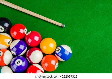 Billiard balls on green table with billiard cue, Snooker, Pool game.
