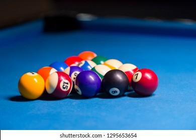Billiard balls on pool blue table - sport background