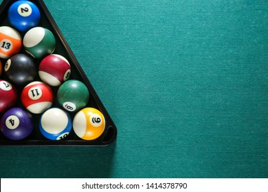 Billiard balls in triangle rack on table