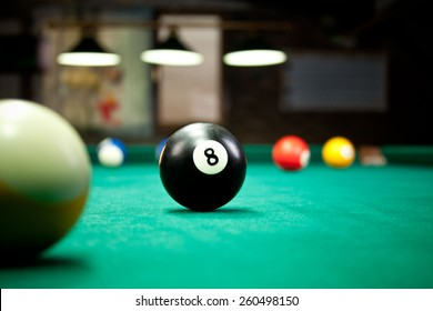 Billiard balls / A Vintage style photo from a billiard balls in a pool table. Noise added for a film effect