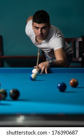 The Billiard Player - Young Man Lining To Hit Ball On Pool Table
