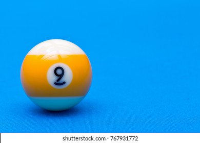Billiard pool game nine ball on billiard table with blue cloth, copy space